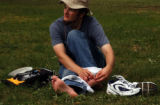 (DENVER, Colo., Aug 6, 2004) Nick Bushnell, parishoner, puts on a bandaid and takes a break in...