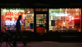 A pedestrian walks past Headwaves near Pearl and Louisiana,  Thursday night November 16, 2006....