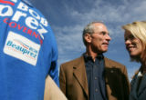Republican gubernatorial candidate Bob Beauprez, center, takes a momentary break from greeting...