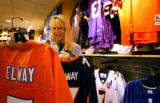 (DENVER, Co., SHOT 8/6/2004) Brenda Rush of Billings, Mont. ponders the purchase of a John Elway...