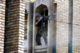 NYT4 - (NYT4) NAJAF, Iraq -- August 22, 2004 -- IRAQ-4 -- A militiaman loyal to Shiite cleric...