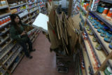 Sarah Hernandez, (cq), store employee, looks for places for items to stock the shelves. Vitamin...