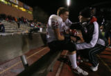 (DLM3571) -  Fairview running back coach Larry Runnels talks with running back Arthur Jaffee after...