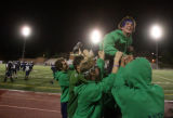 (DLM3835) -   Overland High School fan Joel Greenberg is hoisted up by a group of other students...