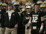 The University of Colorado Buffaloes red shirt freshmen Cody Hawkins, right, stands with his dad...