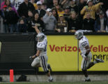 Kansas State receiver Jordy Nelson, LEFT, and quarterback Josh Freeman, right, celebrate Nelson's...