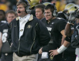 The University of Colorado Buffaloes red shirt freshmen Cody Hawkins, right, stands behind his dad...