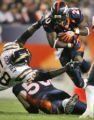 [ES222] - Denver Bronco running back Mike Bell avoids the grip of San Diego line backer Randall...