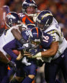 In the fourth quarter, the Denver Broncos Jake Plummer (#16, QB) is warpped up by the San Diego...