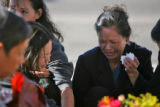 So Le Nguyen grieves at a memorial for her son, Nhan Nguyen and his friend, Jesse Aguirre, at...