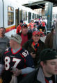Bronco fans disembark the E Line on the new southeast RTD Light Rail at the Invesco Field Sunday...