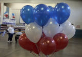 Balloons were the decoration of choice for the Democratic rally held inside the 4 H Building at...