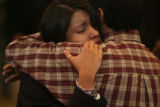MJM409 Locked in a tearful embrace, New Life Church member, Edith Quezada (cq) hugs her father,...