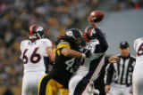 (JPM316)  Denver Broncos Jake Plummer, #16, takes a shot to the back from  Pittsburgh Steelers...