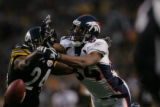 (JPM438)  Denver Broncos Javon Walker, right, narrowly misses a pass against Pittsburgh Steelers...