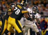 The Denver Broncos Elvis Dumervil (#92, DL) gets double teamed by the Pittsburgh Steelers Max...