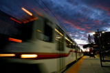 (DLM5792) -  A light rail train departs the new University of Denver Station on its way to the...
