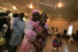 Hawa Konneh from Liberia in pink, has been here a year. She is dancing with her daughter Isha, 10,...