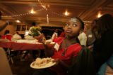 Taking more then you can chew - Viola Konneh, 6 from Liberia pauses after filling her plate with...