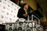 Major League Soccer Player Cobi Jones, cq, speaks during a press conference as he joined Sports...