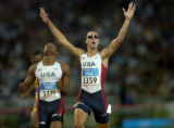 (ATHENS, GREECE-AUGUST 23, 2004) United States' Jeremy Wariner, right, edges past USA's Otis...