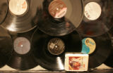 "JPM304 Vinyl records and an Elvis Presley ""Greatest Hits"" 8-track tape drilled into the..."