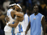 The Denver Nuggets Carmelo Anthony (#15) embraces teammate J.R. Smith (#1) as time expires against...