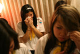 MJM138 Lana Tran (cq), 16, left, and Mary Van (cq), 15, right, members of the Thieu Nhi Thanh The...