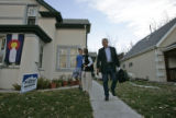 7:33 a.m. Bill Ritter, Democratic candidate for governor makes his way down the family's sidewalk...