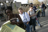 "Bernice Boachie (cq) (l), from Denver, works on her ""cheat sheet"" while waiting in line..."