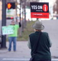 Pam Matas (cq) was holding a sign supporting yes on i while on the corner of Colfax Ave. and...