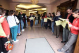Election Day voters at the voting center inside Park Hill United Methodist Church in Denver stand...