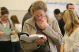 Amy Telligman (cq) reads an enviornmental book while waiting with other Election Day voters at the...