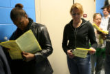 Darla Ruff, cq, and Jessie Hazen, cq, (lt-rt) read over their sample ballots as they wait in line...