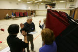 (Timeshot: 06: 52) Election judges for precinct 236 in Centennial take an oath 8 minutes before...