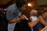 (DENVER, Colo., August 23, 2004) Dora Dreiling, Adams County Deputy Sheriff, tests finger strength...
