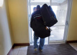 Eddy Lundstrom (cq, center), 22, takes off for the Rapid City, S.D. airport with his dad Ed...