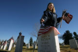 MJM317  Rosann Deusa (cq) of Arvada places flags near the graves of veterans at Fairmount Cemetery...