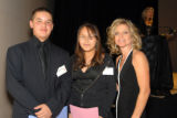 Student speakers Felipe Lomeli, 8th grader from Annunciation, and Brandy Trujillo, 8th grader from...