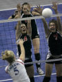 The Durango Demons Colleen Keresey, Tess Attebery, and Arcadia Paine, right, all leap to block...