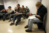 Christopher Perrecone   (r) listens to a woman in his Principles of Land Use Planning class at...