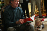 "(DLM1311) -  Chloe Kuhn, 22 months, right, listens to Colorado Governor Bill Owens read ""How..."