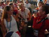 (ATHENS, GREECE, AUGUST 9, 2004- Kelly Kretschman, right, films teammates from the United States...