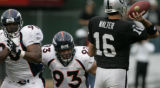 (BG0376} Denver Broncos#90 Kenny Peterson, left, and Michael Myers put pressure on Oakland Raiders...