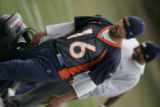BG1825  Denver Broncos Jake Plummer heads into the lockerroom after  the first practice with Jay...