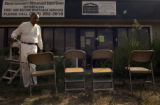 (DENVER, Colo., AUG. 9, 2004)  Mr. Thom Foster sets up chairs for a press conference in front of...