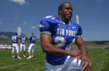 (Colorado Springs, Colo., August 9, 2004) Fullback Adam Cole stretches at the Air Force Academy's...