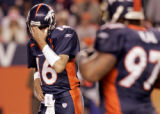 Denver Broncos quarterback Jake Plummer reacts to Cecil Sapp dropping what would have been a...