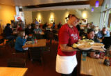 Bria Date, (cq), server, works her job delivering the goods. Noodles & CO, 1245 Alpine Ave.,...