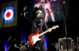 slideshow 5-Legendary rock guitarist, Pete Townshend, of the band The Who gets his scarf caught in...